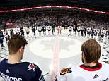 The Chicago Blackhawks and the Winnipeg Jets skated into a circle for a moment of silence at center ice, as an image of the Humboldt Broncos was displayed on the big screen at the start of Saturday morning's game