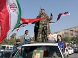 On April 14, the morning after a coordinated missile attack by the US, UK and France in Damascus, Syrians take to the streets in support of President Bashar al Assad