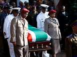 The coffin of Winnie Madikizela-Mandela is carried from her home during her funeral in Soweto, South Africa April 14, 2018 - the ceremony concludes 10 days of national mourning during which time thousands of South Africans have paid tribute to the 'Mother of the Nation' at her Soweto home and elsewhere