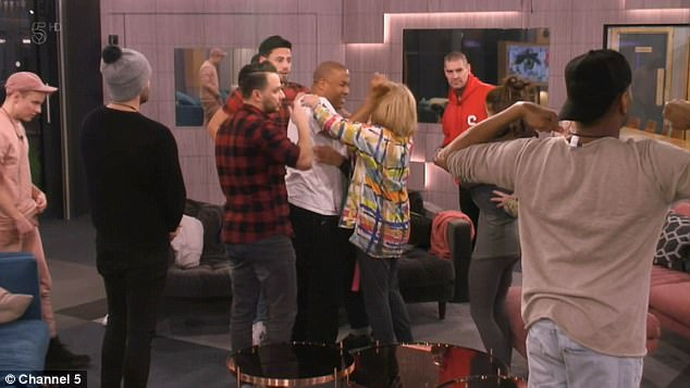 Group hug: The stars immediately flocked to John, who was a popular member of the house