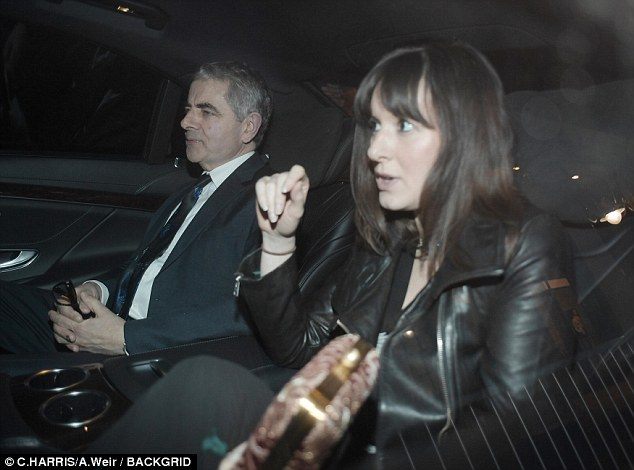 Date night:Rowan Atkinson, 63, and his girlfriend Louise Ford, 34, attended musical icon Sir Andrew Lloyd Webber's 70th birthday bash at London's Theatre Royal Drury Lane on Thursday