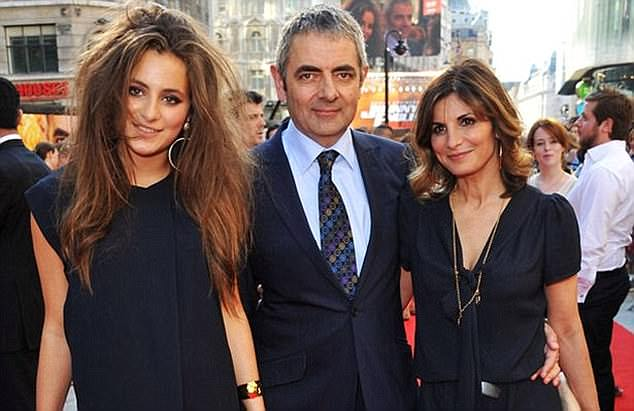 In the past: Rowan Atkinson already had two children from his previous marriage to Sunetra Sastry (right) - Lily, 21 (left), and a sonBen, 23 (not pictured)