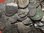 The April 13, 2018 photo shows medieval Saxonian, Ottoman, Danish and Byzantine coins after a medieval silver treasure had been found near Schaprode on the northern German island of Ruegen in the Baltic Sea.  (Stefan Sauer/dpa via AP)