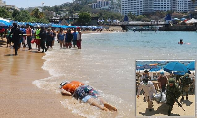 Body of shooting victim floats ashore in front of tourists in Mexico