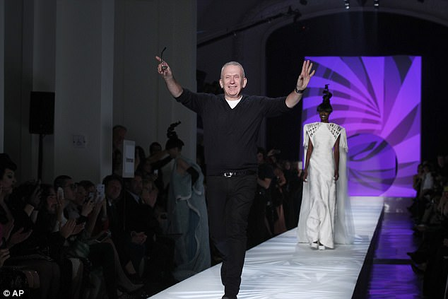 Round of applause: The designer later lapped up the applause as he took a bow after his catwalk