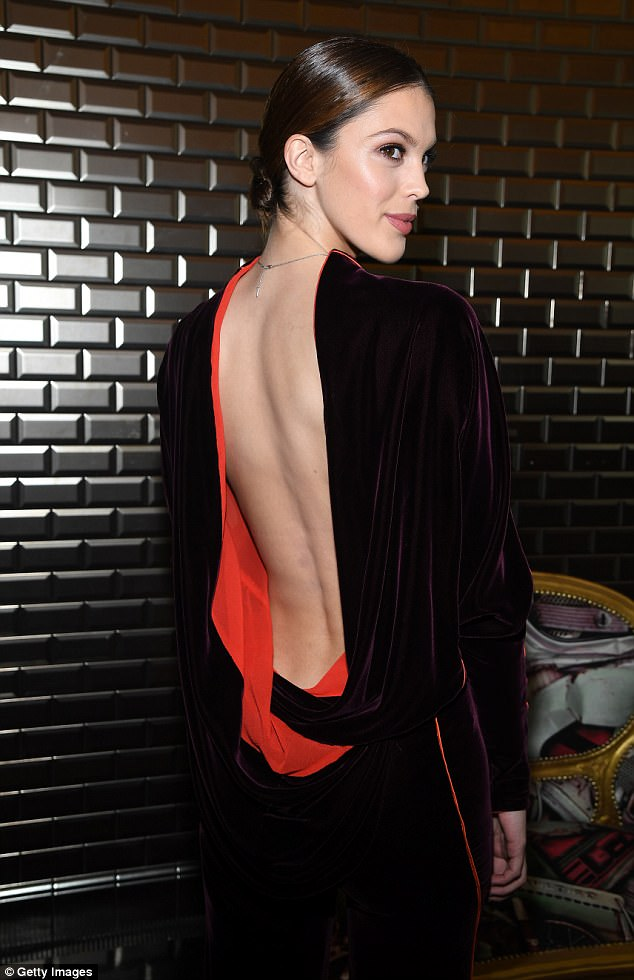 Gorgeous: Meanwhile French modelIris Mittenaere gave a saucy flash of skin in her backless velvet jumpsuit