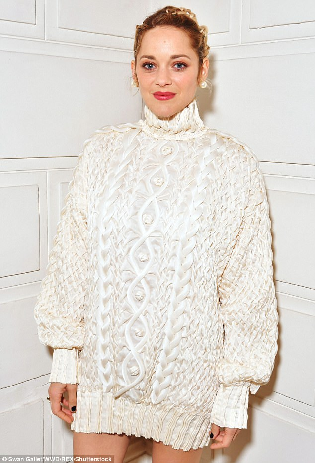 Casual glamour:The La Vie En Rose star was effortlessly chic in the oversized jumper, formed of a high-shine cream cable knit material