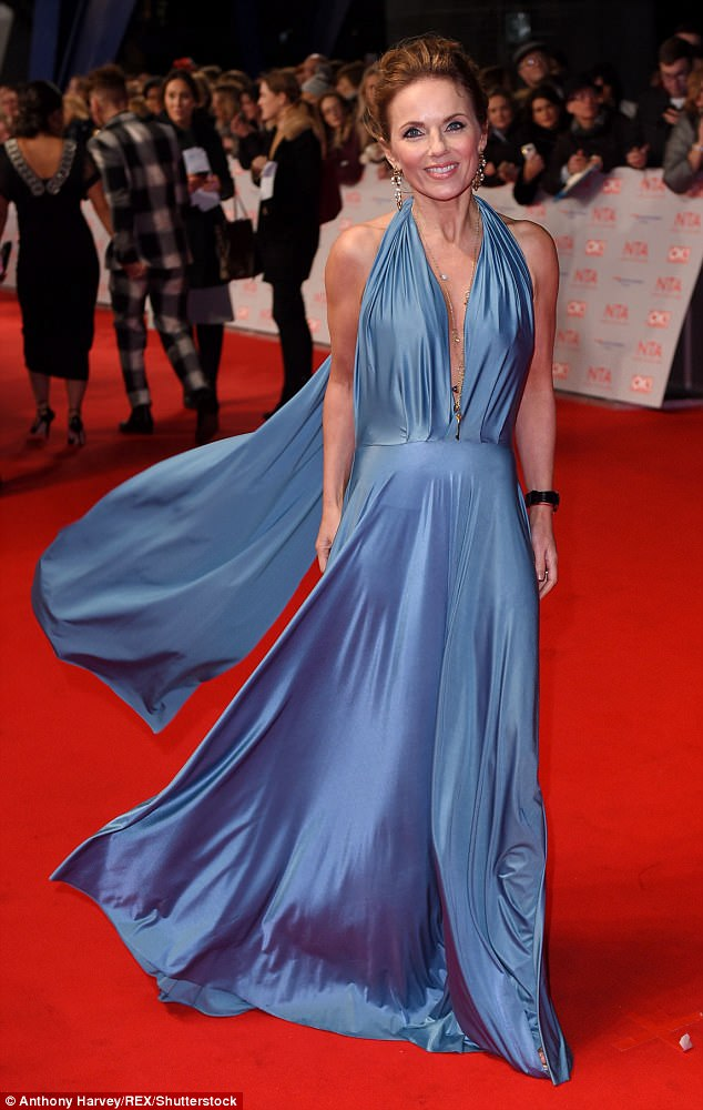 Svelte: Geri Horner, 45, commanded attention in an elegant blue silk gown as she attended the National Television Awards on Tuesday evening