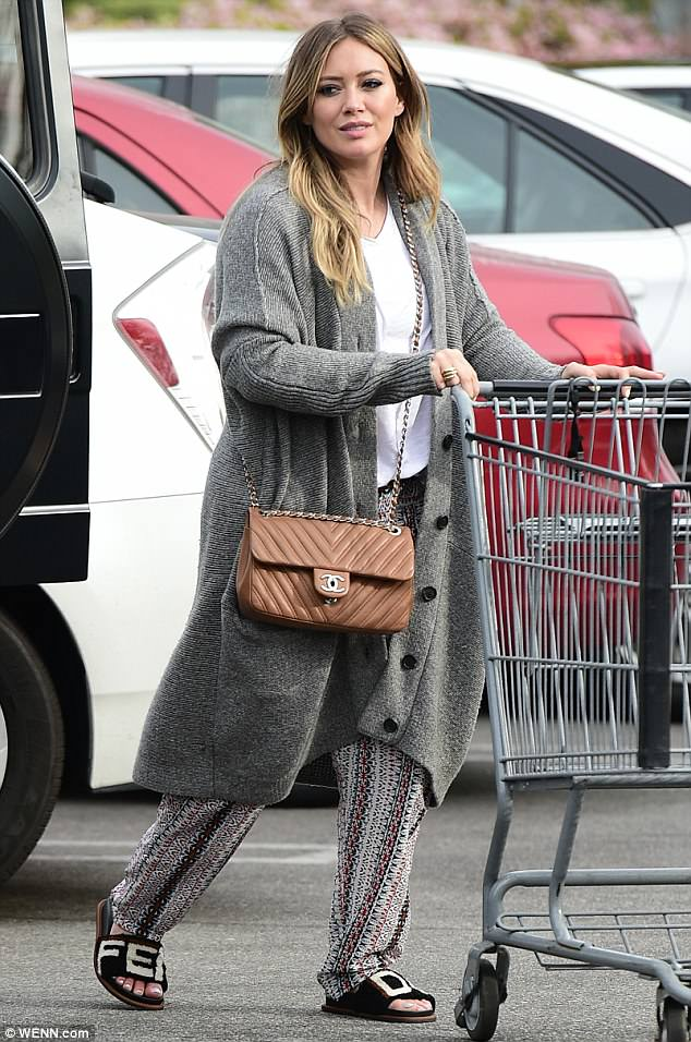 Casually expensive: Hilary Duff rocked $900 Fendi furry slides and a $5,000 Chanel purse for a casual grocery shopping trip on Sunday