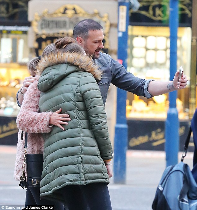 Time for a snap:Paddy was spotted strolling back to his waiting chauffeur-driven Mercedes but stopped for a selfie with a couple of female fans on the way