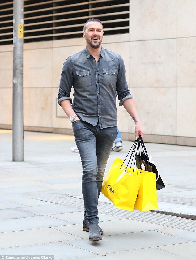 Pleased with yourself, Paddy? He looked smug about his purchases as he dipped into his car and headed off