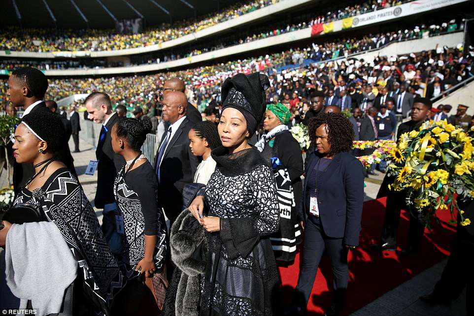 Family members arrive as Winnie Madikizela-Mandela coffin is brought into Orlando stadium in Soweto, South Africa, on Saturday
