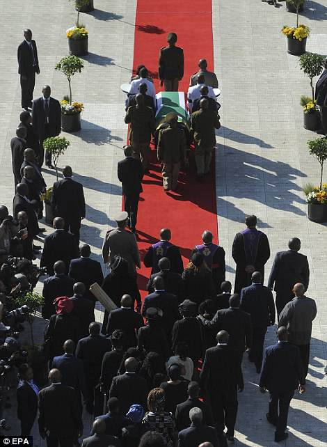 The coffin of Winnie Mandela is carried into Orlando stadium for the official state funeral in Soweto