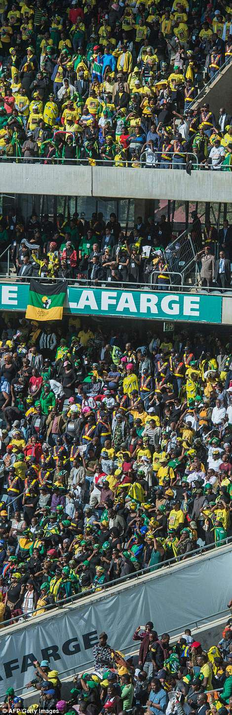 Mourners attend the funeral ceremony of Winnie Mandela at the Orlando Stadium in Soweto