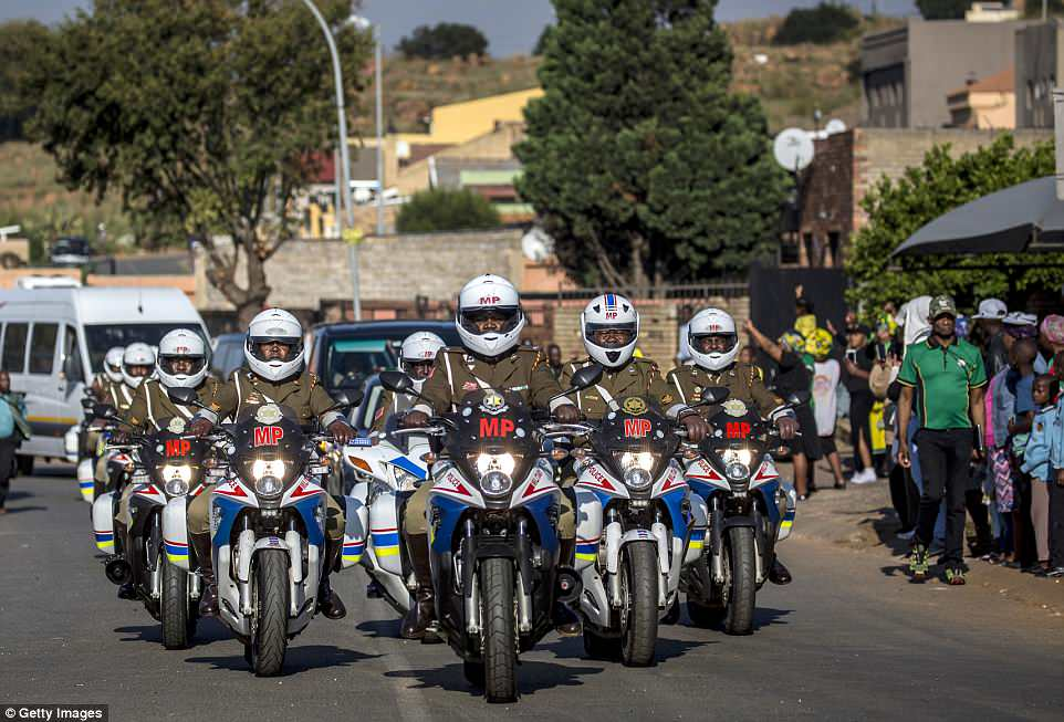 Military Police lead the front of the convoy bringing the body of Winnie Mandela to Orlando Stadium for her funeral on April 14, 2018, in Soweto