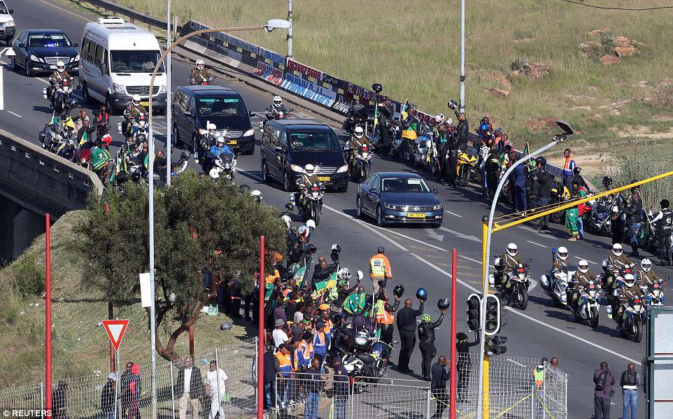 People line the streets to pay their respects as the funeral cortege for Winnie Mandela arrives at Orlando stadium in Soweto