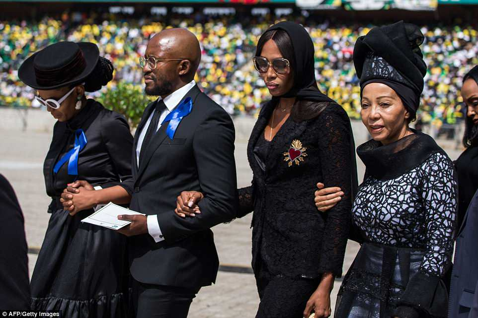 Campbell walks with her mother Valerie Morris (right) and members of the Mandela family as they arrive at the funeral
