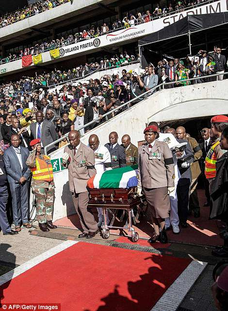 South African military personnel bring in the coffin at Orlando Stadium for the funeral ceremony in Soweto, South Africa on Saturday