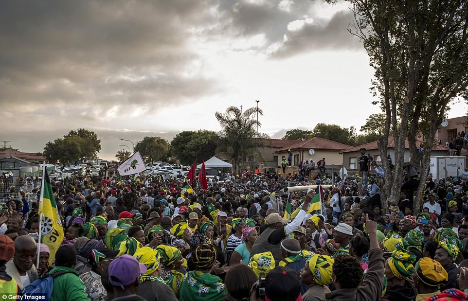 This breathtaking photo best shows just how many people turned out to welcome Winnie's body back to her home on Friday, with ANC flags and waving supporters covering the entire area
