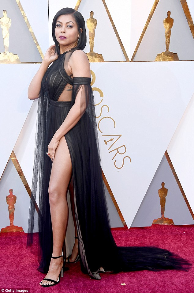 Leggy beauty: The garment featured a high split, which the Empire starlet used to full effect, poking out one of her toned pins as she posed on the carpet