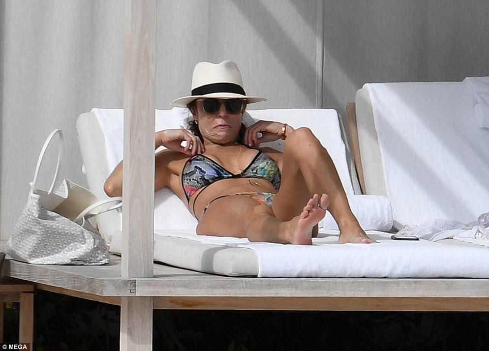 Repose: The Skinnygirl impresaria was wearing her shades and a hat when she was snapped lounging back on a comfortable-looking deck chair