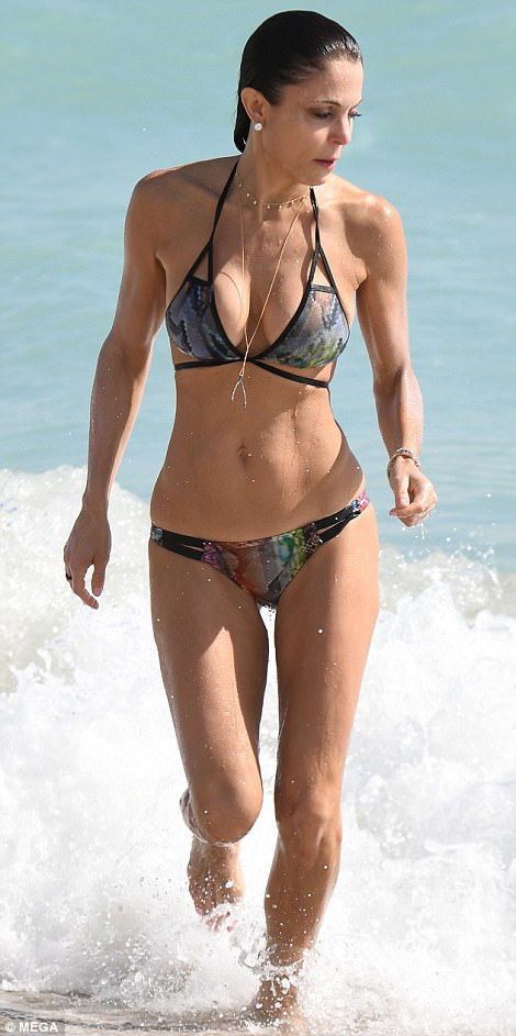 Back and forth: Her bikini featured a darker purple, navy, green and bronze pattern at the front, though at the rear it had a brighter color combo