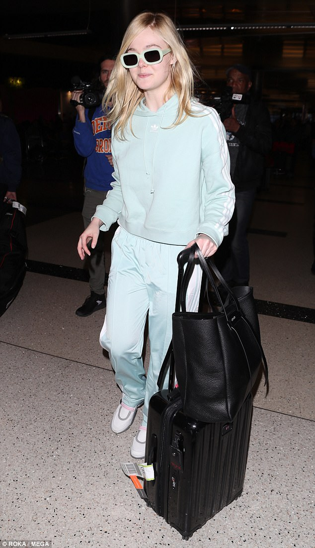 Well suited! Elle Fanning put comfort over fashion Wednesday while touching down at Los Angeles International Airport wearing an aqua tracksuit