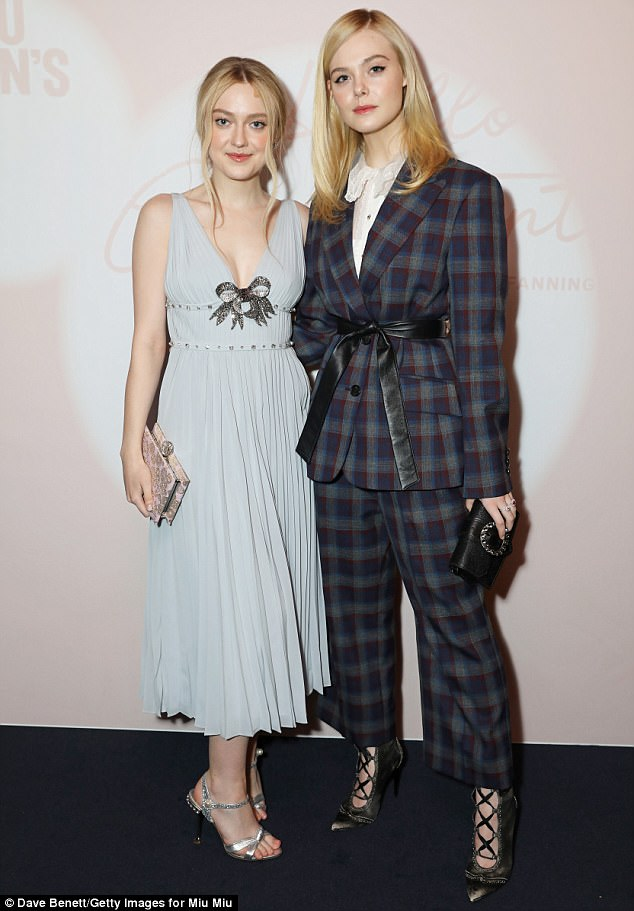 Sibling love! Just Tuesday the beauty was seen across the pond in England, where she was enjoying London Fashion Week with older sister Dakota, left