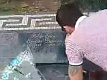 One toot in the grave: Footage captures the moment a British tourist appears to snort cocaine off the grave of Colombian drug lord Pablo Escobar