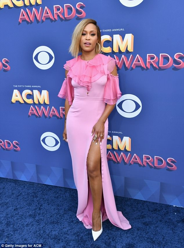 Pretty in pink!Eve was certainly winning in the style stakes as she attending the ACM Awards Saturday in Las Vegas in a pretty pink dress that showcased plenty of leg