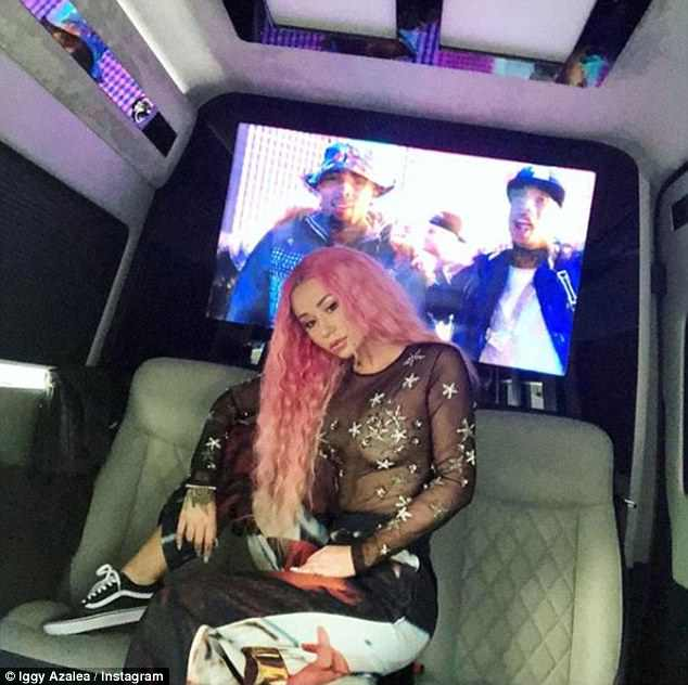 Riding in style!Meanwhile, a second photograph uploaded on Monday showed the star wearing the translucent top as she travelled in the back of a limousine