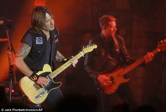 Getting into it: Keith rocked out in time with a guitarist in his band