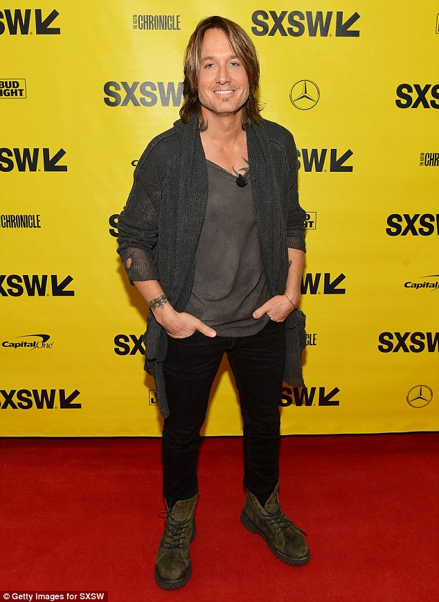 Not exactly rocker style: The 12-time CMA Award winner wore a long knitted cardigan over a loose gray T-shirt and black skinny pants at SXSW in Austin, Texas