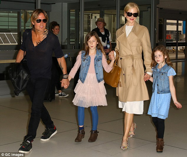 His support system: The proud mom and dad with their daughters Sunday Rose, nine and Faith, seven, in Sydney in March 2017