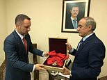 A picture released on Syrian President Bashar al-Assad's Facebook page shows a foreign affairs official giving France's Legion d'Honneur Grand Croix award to a representative from the embassy of Romania, which represents French interests in Syria