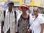 Gretel Gorcan, 81, (pictured with children Pauline Blackwood (right) and Wilton Foster (left) is  penniless and cut off from her family since going to her sister's funeral in Jamaica