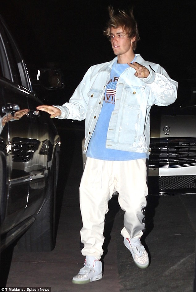 Excited: Justin was all smiles as he arrived to The Roxy to support British music star David with his crew