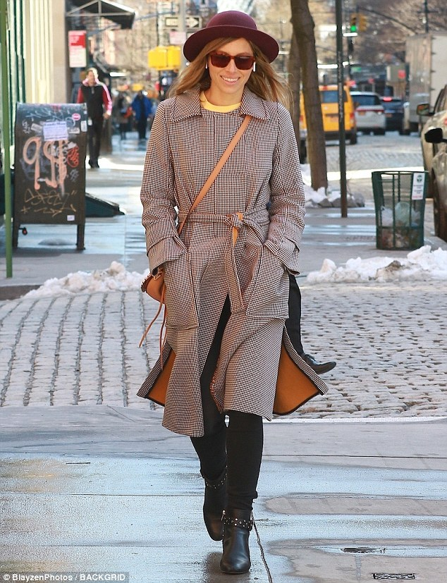 Solo stroll: Jessica Biel stuns in a black-and-white gingham coat as she walks through an NYC neighborhood on Thursday