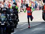 Sir Mo Farah collapses on the ground after finishing the men's elite race in third place on a sweltering day in London