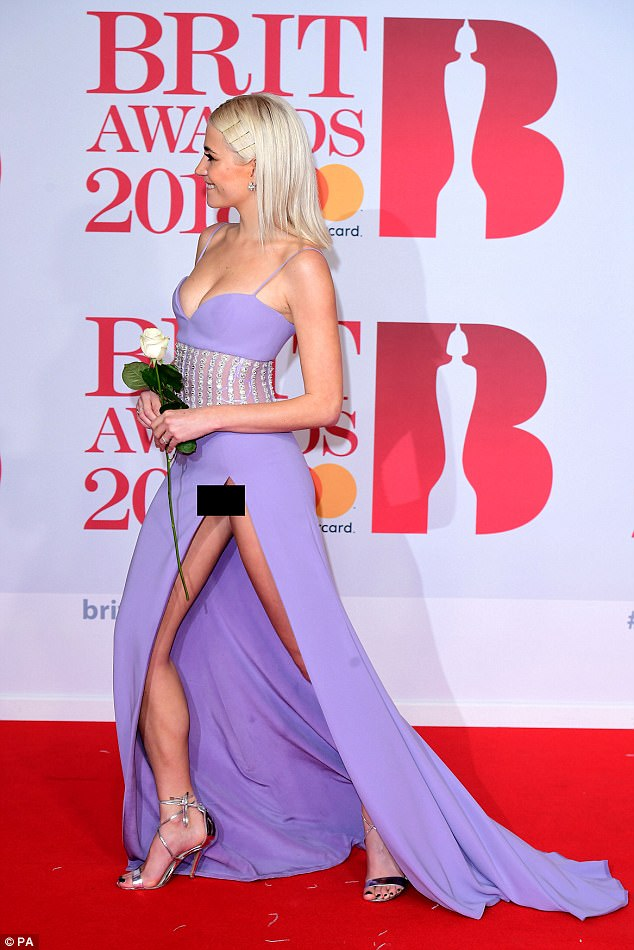 A little bit too much! Pixie gave away a bit too much as she sauntered further down the red carpet