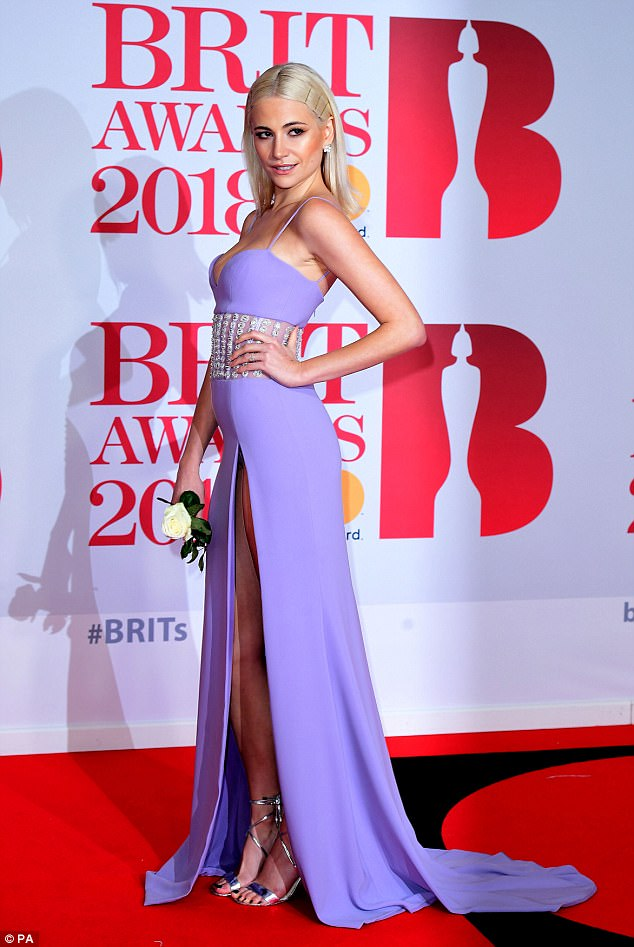 Making a statement: The blonde beauty carried a white rose for her turn on the red carpet, joining numerous other stars who toted the flower as part of their outfit