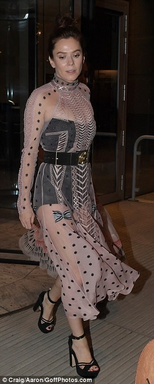 Vintage-inspired: Under this she wore a black all-in-one body, showing off her toned pins beneath the light pink lacy dress that covered the outfit