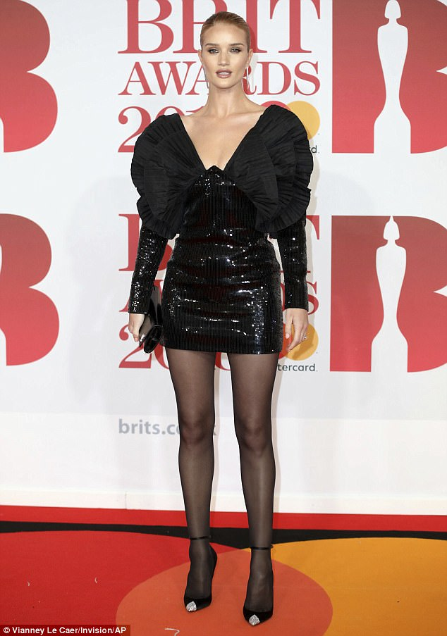 Retro look:On a night dedicated to the best in contemporary music, Rosie Huntington-Whiteley gave a nod to the past at the 2018 BRIT Awards on Wednesday evening