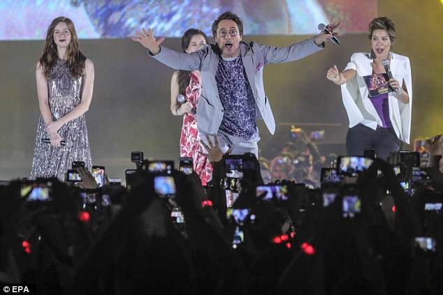 Watch out! The Iron Man hunk pretended to stage dive into the adoring crowd