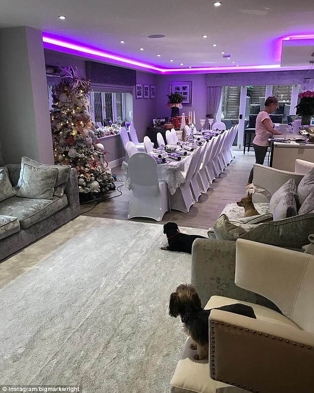 Ready for Christmas: Showing off his lavish living room and kitchen festooned in disco lights and festive decorations, Mark Snr joked: 'Yes I can safely say the house has now been taken over for sure'