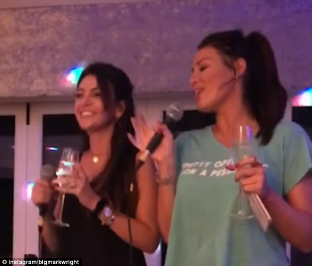 Loving life: The beaming Our Girl actress, 30, sipped a glass of champagne and danced along with former TOWIE star Jess during the festive family party with her in-laws