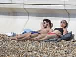 Britons were spotted enjoying the spring sunshine on Wimbledon Common in south west London yesterday but the mini-heatwave is set to come to an endas rain hits the country
