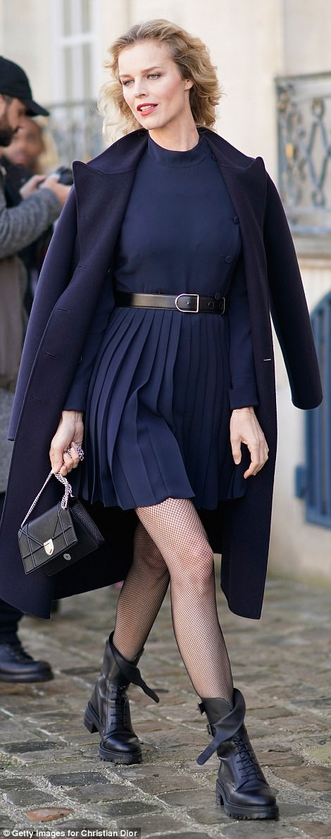 Glamour: Eva Herzigova lived up to her supermodel status as she arrived in a sensational navy skirt and matching jacket which was effortlessly draped off her shoulders