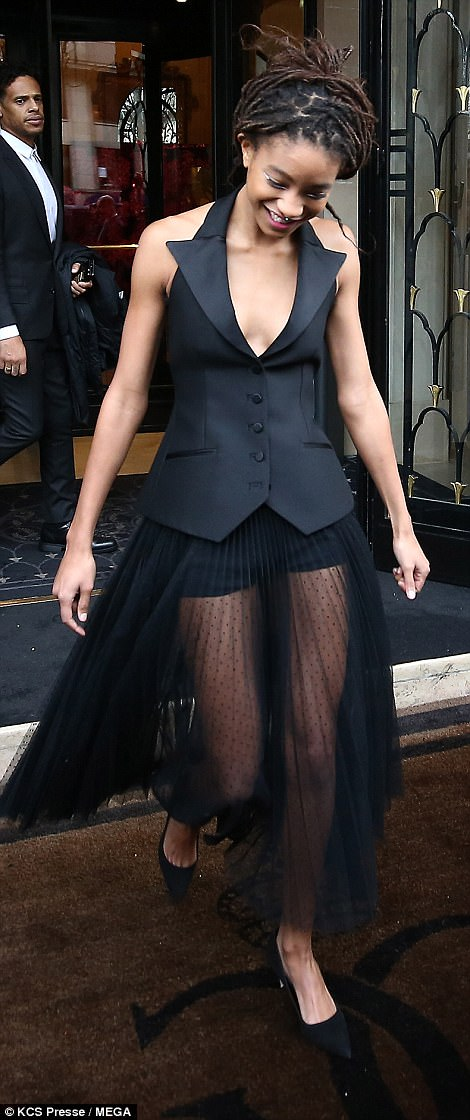 Teen style: Willow, the daughter of Will and Jada Pinkett Smith, stuck to her signature sense of style as she rocked up to the event in the sleeveless button-down waistcoat