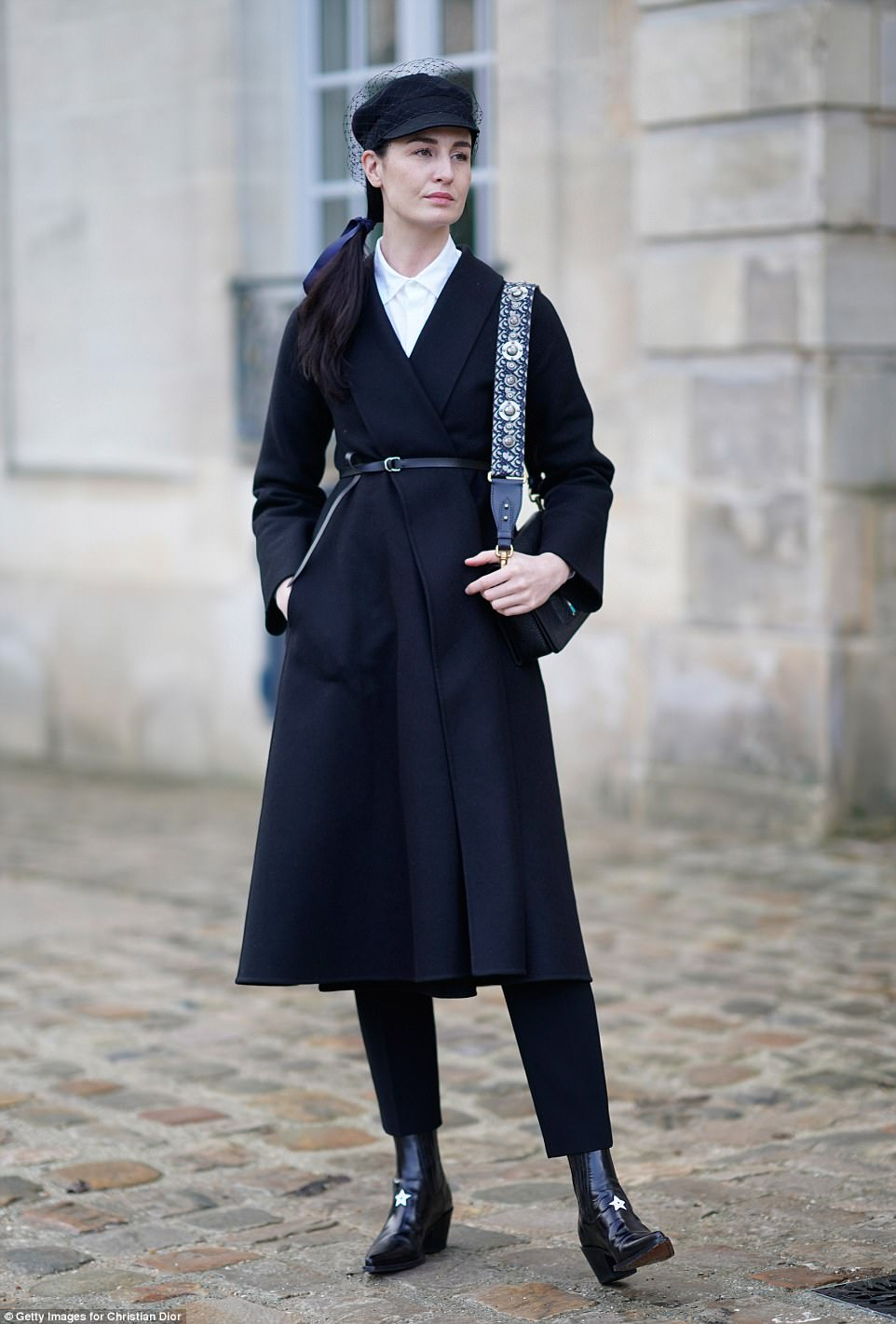 Supermodel: Erin O'Connor looked fabulous as she wrapped up in a chunky black waist-cinching  jacket and sensational baker boy cap